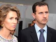 Asma und Baschar al-Assad in einer Aufnahme von Juli 2010 in Tunis. (Bild: KEYSTONE/AP/Hassene Dridi)