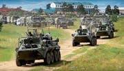 Russische Militärfahrzeuge beim Grossmanöver «Wostok 2018» am Dienstag in Ostsibirien. (Bild: AP)