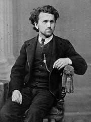 Ein Mann sucht die Karriere: Selbstbewusst inszeniert Ulrich Baumann sich im Jahr 1874 als junger Anwalt mit Uhrenkette und Künstlermähne. (Bild aus: Werner Baumann, Ein Mann des Volkes, Chronos-Verlag)