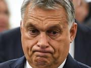Er pfeift auf die EU: der ungarische Ministerpräsident Viktor Orban. Bald wird sein Land aber ein Strafverfahren am Hals haben. (Bild: KEYSTONE/EPA/PATRICK SEEGER)