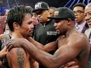 Floyd Mayweather (rechts) will nochmals gegen Manny Pacquiao boxen (Bild: KEYSTONE/FR159466 AP/ISAAC BREKKEN)