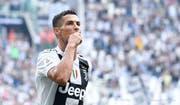 Cristiano Ronaldo bejubelt ein Tor in einem Spiel mit Juventus gegen US Sassuolo in Italiens Serie A. (Bild: EPA/Alessandro di Marco (Turin, 16. September 2018)).