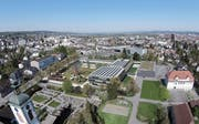Flach aber lang soll es werden: Aber der Baubeginn des neuen Kreuzlinger Verwaltungsgebäude auf dem Bärenplatz verzögert sich. (Bildmontage: PD)