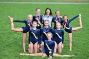 Die K2-Turnerinnen; kniend von links: Nora Baumann, Nora Albert, Isabelle Kempf, Livia Arnold, Sara Droese; hinten von links: Gina Gisler, Marija Dreivinga, Patrizia Herger; vorne: Siegerin Valeria Gamma. (Bild: PD)