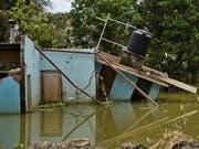 Starke Regenfälle verursachen im Norden Indiens schwere Überschwemmungen. (Bild: KEYSTONE/AP/R S IYER)