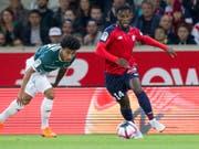 Jonathan Bamba steuert eine Doublette zu Lilles Sieg im Verfolgerduell gegen Marseille bei (Bild: KEYSTONE/AP/MICHEL SPINGLER)