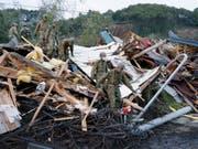 Nach dem verheerenden Erdbeben im Norden Japans am Donnerstag finden Rettungskräfte immer mehr Todesopfer. (Bild: KEYSTONE/AP Kyodo News/YUSUKE OGATA)