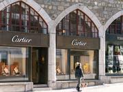 Der Luxusgüterkonzern Richemont hat im Weihnachtsquartal mit seinen Marken wie Cartier, Piaget oder IWC die Verkäufe gesteigert. (Bild: KEYSTONE/CHRISTIAN BEUTLER)