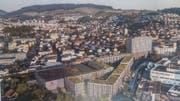 Blick aus Richtung Osten auf die geplante Überbauung mit dem niedrigeren Prodega-Gebäude links. (Visualisierung: Business Images AG)