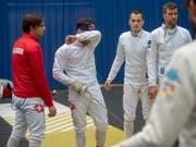 Das Schweizer Männerdegen-Team um Michele Niggeler (links) und Max Heinzer (mit Degen) musste sich in Heidenheim mit dem 8. Rang begnügen (Bild: KEYSTONE/MARCEL BIERI)