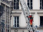 Die Explosion in der Pariser Innenstadt hat vier Todesopfer gefordert. (Bild: KEYSTONE/EPA/IAN LANGSDON)