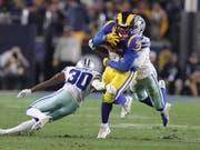 Bei den Los Angeles Rams ragte Runningback C.J. Anderson (im gelb-blauen Dress) mit zwei Touchdowns heraus (Bild: KEYSTONE/EPA/MIKE NELSON)