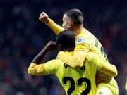 Seydou Doumbia (22) und Borja Garcia in unbändiger Freude nach dem entscheidenden 3:3 (Bild: KEYSTONE/EPA EFE/VÍCTOR LERENA)