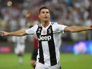 Cristiano Ronaldo zeigt eine gemässigte Freude nach seinem Siegestor gegen Milan (Bild: KEYSTONE/AP)