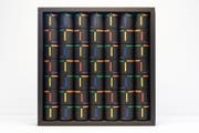 """Das Wandobjekt """"Partixipate"""" von Roland Humair besteht aus 49 Zylindern. Werden diese gedreht, entstehen immer wieder neue Bilder. (Bild: F.X. Brun)"""