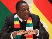 Simbabwes Präsident Mnangagwa lässt sich am Weltwirtschaftsforum in Davos von Finanzminister Mthuli Ncube vertreten. (Bild: KEYSTONE/AP POOL TASS News Agency/NATALIA FEDOSENKO)