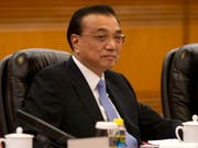 Der chinesische Ministerpräsident Li Keqiang zeigt sich für das Wirtschaftswachstum seines Landes optimistisch. (Bild: KEYSTONE/EPA AP POOL/NG HAN GUAN / POOL)