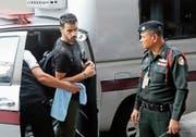 Hakeem al-Araibi auf dem Weg zu einem Gerichtstermin in Bangkok. (Bild: Diego Azubel/EPA (11. Dezember 2018))