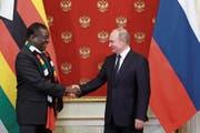 Russlands Präsident Wladimir Putin empfängt seinen simbabwischen Amtskollegen Emmerson Mnangagwa in Moskau. (Bild: Mikhael Klimentyew/Sputnik (15. Januar 2019))