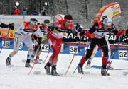 Tour-Leader Christoph Eigenmann 2007 zwischen Bjoern Lind (SWE) und Roddy Darragon (FRA). (Bild: Urs Huwyler)
