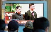Der nordkoreanische Machthaber Kim Jong Un und das chinesische Staatsoberhaupt Xi Jinping. Bild: Ahn Young-Joon/AP (Seoul, 8. Januar 2019)