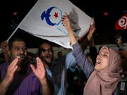 Anhänger der muslimischen Ennahdha-Partei feiern ihren Wahlerfolg. (Foto: Riadh Dridi/AP Keystone) (Bild: KEYSTONE/AP/RIADH DRIDI)