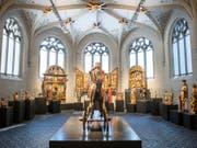 Die Holzskulptur «Christus auf dem Palmesel» aus dem 11. Jahrhundert ist Teil der Sammlungsausstellung im Landesmuseum in Zürich. Eingerichtet ist die Ausstellung im sanierten Westflügel des Museums. (Bild: Schweizerisches Nationalmuseum)