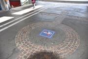 Dieser «Rauchfrei»-Hinweis im Zugang zum Bahnhof Buchs erinnert die Raucher daran, ihren Glimmstängel auszudrücken.