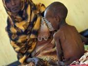 Die Zahl der weltweit hungernden Menschen ist von 785 Millionen im Jahr 2015 auf derzeit 822 Millionen gestiegen. (Bild: KEYSTONE/AP AFP POOL/TONY KARUMBA)