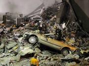 Rettungskräfte auf der Suche nach Überlebenden nach dem Erdbeben in Christchurch im Februar 2011. (Bild: Keystone/AP Kyodo News/SHUZO SHIKANO)
