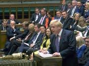 Scheitert mit seinen Neuwahl-Plänen: Der britische Premier Boris Johnson bei der Debatte im Unterhaus in London. (Bild: KEYSTONE/AP/HOUSE OF COMMONS)