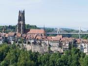 In einer Freiburger Kirche haben zwei Männer versucht, eine Kasse aufzubrechen. (Bild: KEYSTONE/THOMAS DELLEY)