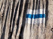 Auf einem blau-weiss markierten Gebirgswanderweg oberhalb von Seelisberg ist eine Wanderin tödlich verunglückt. (Bild: KEYSTONE/ARNO BALZARINI)