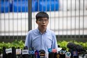 Joshua Wong nimmt Stellung zu seinem Ausschluss von den Kommunalwahlen im November 2019. (Bild: Jerome Favre/EPA (29. Oktober 2019))