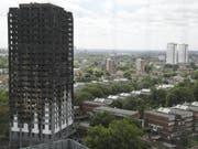 Der ausgebrannte Grenfell Tower in London. Zwei Jahre nach dem verheerenden Brand mit Dutzenden Toten wirft ein offizieller Bericht der Feuerwehr schwere Versäumnisse vor. (Bild: Keystone/AP/FRANK AUGSTEIN)