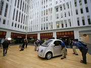 Roboterautos, die mit Waymo-Technologie ausgerüstet sind, sollen bald durch die kalifornische Metropole fahren. (Bild: KEYSTONE/AP/ERIC RISBERG)