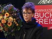 Die gebürtige Deutsche und in der Schweiz lebende Autorin Sibylle Berg wird für ihre «eispickelharte Gesellschaftskiritk «GRM. Brainfuck.» mit dem Schweizer Buchpreis 2019 geehrt. (Bild: Keystone/EPA KEYSTONE/GEORGIOS KEFALAS)