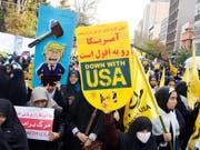 Alle Jahre wieder: Protest gegen den «Satan» vor der US-Botschaft in Teheran. (Bild: KEYSTONE/EPA/ABEDIN TAHERKENAREH)