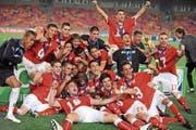Das legendäre Jubelbild: Die Schweizer U17 in Ekstase nach dem Sieg im WM-Final 2009. (Bild: Pius Utomi Ekpei/AFP (Abuja, 15. November 2009))