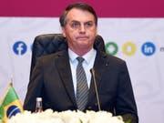 Brasiliens Parlament hat am Mittwoch die Reform des Waffenrechts abgeschwächt und damit dem Präsidenten des Landes, Jair Bolsonaro, erneut einen Dämpfer bei seinem Wahlkampfversprechen versetzt. (Bild: KEYSTONE/EPA/STR)