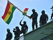 Zahlreiche Sicherheitskräfte in Bolivien haben sich den Protesten gegen den Präsidenten Evo Morales angeschlossen. (Bild: KEYSTONE/EPA EFE/JORGE ABREGO)