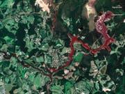 Nach dem Dammbruch an der Mine Córrego do Feijão am 25. Januar ergossen sich rund zwölf Millionen Kubikmeter Schlamm auf eine Fläche von etwa 290 Hektar. Mindestens 169 Menschen kamen dabei ums Leben. (Bild: KEYSTONE/AP DigitalGlobe)
