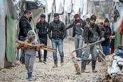 Aufräumarbeiten im Flüchtlingslager im libanesischen Bar Elias. Bild: Marwan Naamani/DPA (13. Januar 2019)