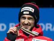Strahlen mit der Bronzemedaille: Killian Peier erhielt in Seefeld seinen verdienten Preis (Bild: KEYSTONE/PETER SCHNEIDER)