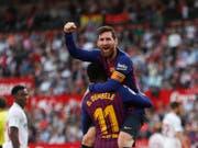 Lionel Messi schwang auch in Sevilla obenaus und erzielte drei Tore (Bild: KEYSTONE/AP/MIGUEL MORENATTI)