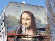 Mona Lisa lächelt neu in Übergrösse in Berlin. (Bild: KEYSTONE/dpa/ANNETTE RIEDL)