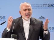 Der iranische Aussenminister Mohammed Dschawad Sarif - hier bei der Sicherheitskonferenz in München - ist nach der Ablehnung seines Rücktritts zurück im Amt. (Bild: Keystone/DPA/TOBIAS HASE)