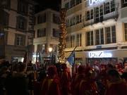 Der Maskenbrunnen der MLG auf dem Kornmarkt in der Luzerner Altstadt. (Bild: Jérôme Martinu)
