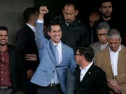 Die internationale Anerkennung des selbsternannten venezolanischen Interimspräsidenten Juan Guaidó wirft völkerrechtliche Fragen auf. Das stellen Gutachter des deutschen Bundestages in einer Expertise fest. (Bild: KEYSTONE/AP/ARIANA CUBILLOS)