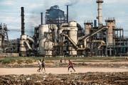 Müssen Mutterfirmen für Umweltschäden haften, welche ihre Tochterfirmen im Ausland verursachen? (Bild: Kadir van Lohuizen/Noor (Kankoyo, 13. August 2017))